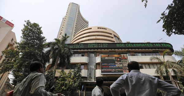 Nifty closes flat after touching 10,000-mark record high, Sensex ends lower