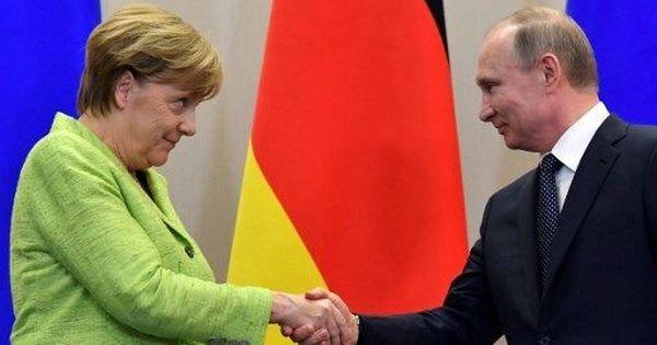 German Chancellor Angela Merkel urges Vladimir Putin to protect gay rights
