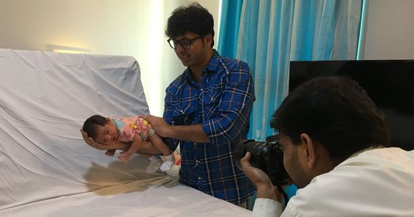 When newborns arrive, hospital maternity rooms turn into photo studios