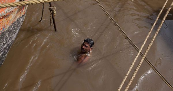 Watch: These sand miners are risking drowning, all for India's building boom