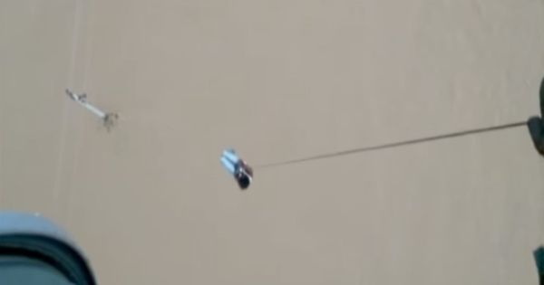 Watch: Man atop electric pole rescued by IAF chopper in flood-hit Gujarat