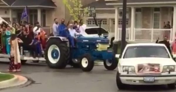 Watch: NRI groom in Canada makes a 'desi' entry to his wedding on a...tractor