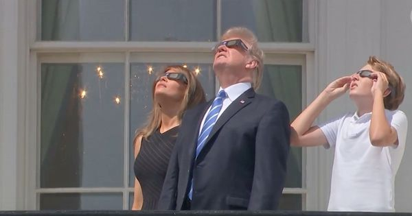 Watch: The solar eclipse held everyone in thrall, including Trump (without protective glasses on)