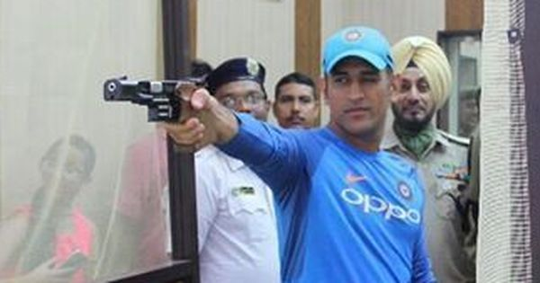 Dhoni hones shooting skills after India's practice session in Kolkata is washed out