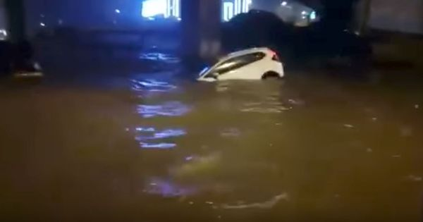 Watch: A Bengaluru woman was trapped inside her car on a waterlogged street. Four men rescued her