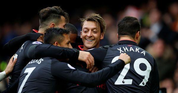 Five-star Arsenal send Everton into drop zone despite Wayne Rooney's wonder goal