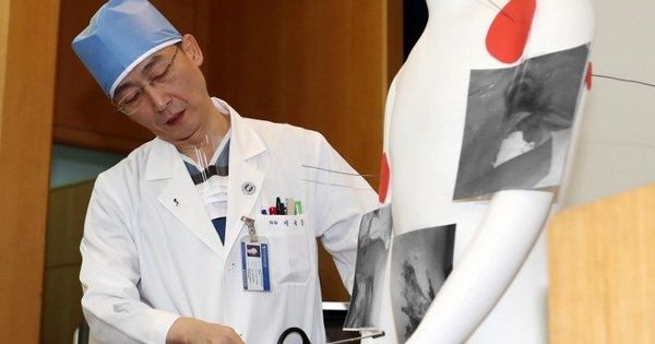 Doctors treating North Korean soldier who defected to the South find 11-inch worm in his stomach
