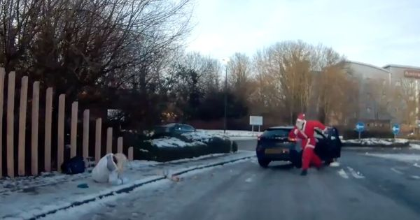 Watch this Christmas wonder as Santa Claus rushes to the rescue of a woman on the street