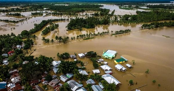 Vietnam evacuates 74,000 people as it braces for Typhoon Tembin; Philippines toll rises to 230