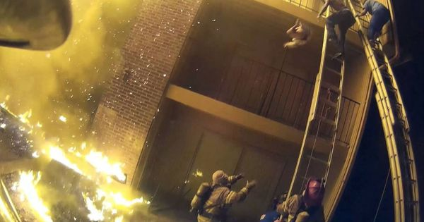 Watch: That heart-stopping moment a firefighter caught a child thrown from the third floor