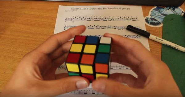 Watch: First, a pencil. Now, a man plays a 'Star Wars' theme on a Rubik's Cube. While solving it