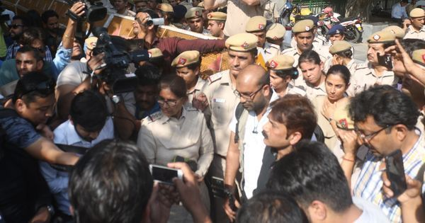 Journalists protest outside Delhi Police headquarters against alleged assault during JNU march