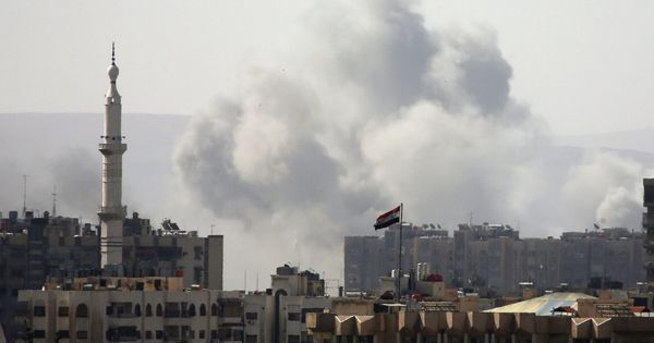 Syrian rebel forces evacuate enclave outside Damascus after Army launches air, artillery attacks
