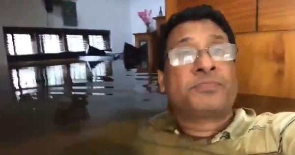 Watch: A man in Kerala sends a distress message standing in neck deep water inside his house