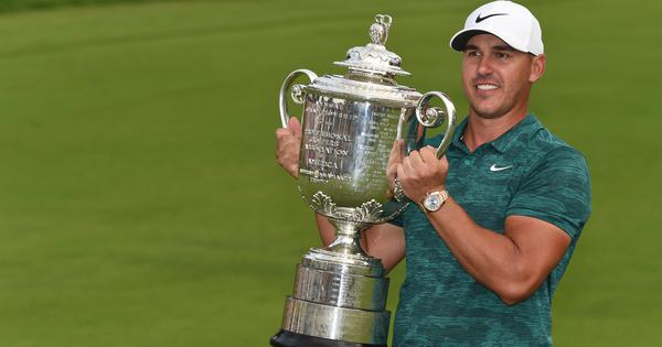 PGA Championships: Brooks Koepka holds off Tiger's charge on final day to claim victory