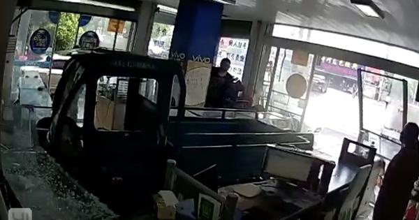 Caught on camera: A dog 'drove' a three-wheeled truck through a glass window of a shop in China