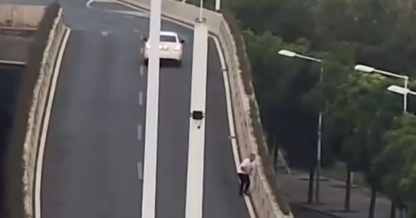 Watch: A man in China jumped off a flyover to avoid a drunk-driving test (but he was sober)