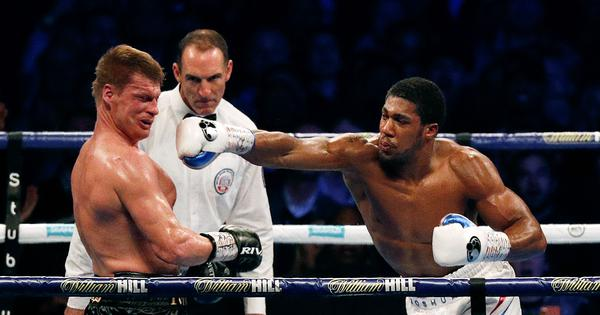 Boxing: Anthony Joshua overpowers Alexander Povetkin to retain world heavyweight titles