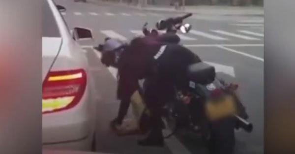 Watch: A motorcyclist in China had a strong response to a woman littering on the street