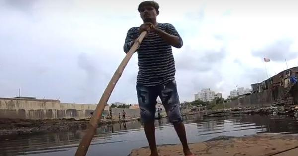 Watch: In Mumbai, this man offers a makeshift raft so that people can cross a filthy canal