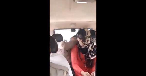 In UP, a police officer assaults a woman inside a vehicle (and another officer shoots a video)