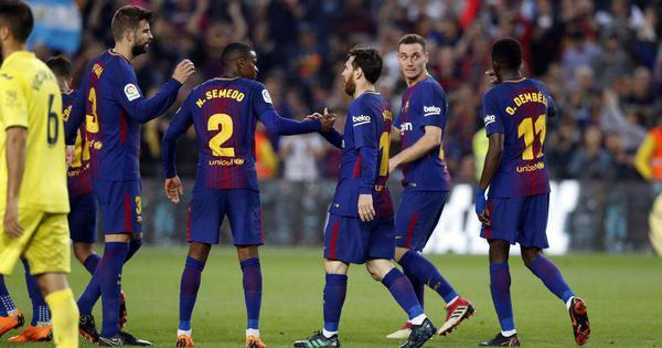 Barca edge closer to completing unbeaten league season, Real Madrid lose to Sevilla