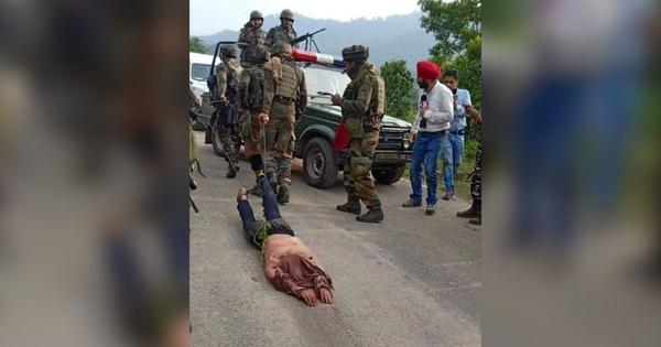 In Kashmir, a photo of a militant's body being dragged by security forces sparks outrage