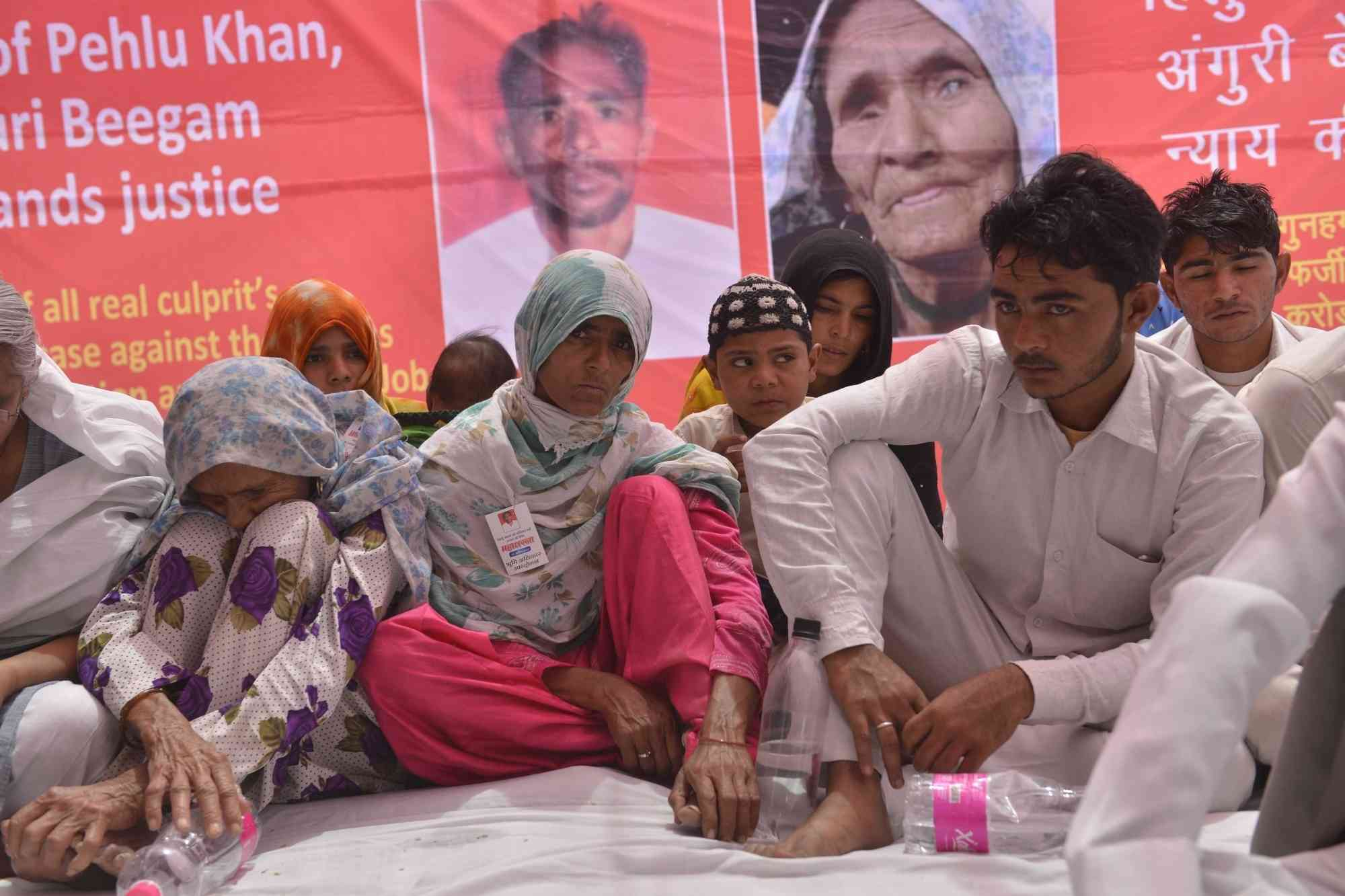 Mother of dairy farmer Pehlu Khan along with her family members stage a sit-in demonstration to demand justice for him, in New Delhi on April 19, 2017. (Photo credit: IANS).