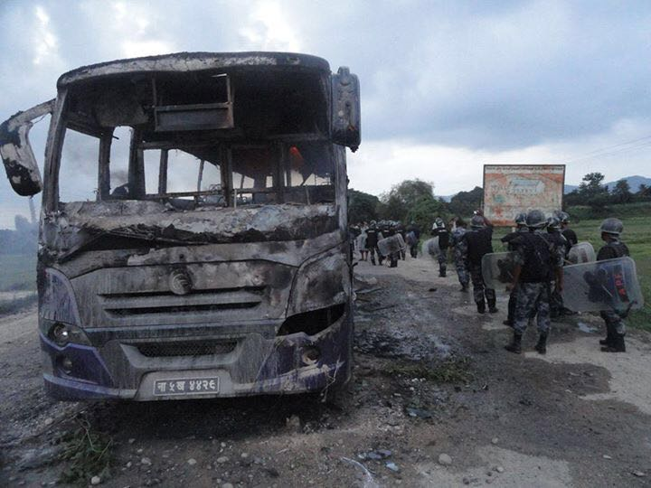 A bus set on fire on the outskirts of Birgunj last September.