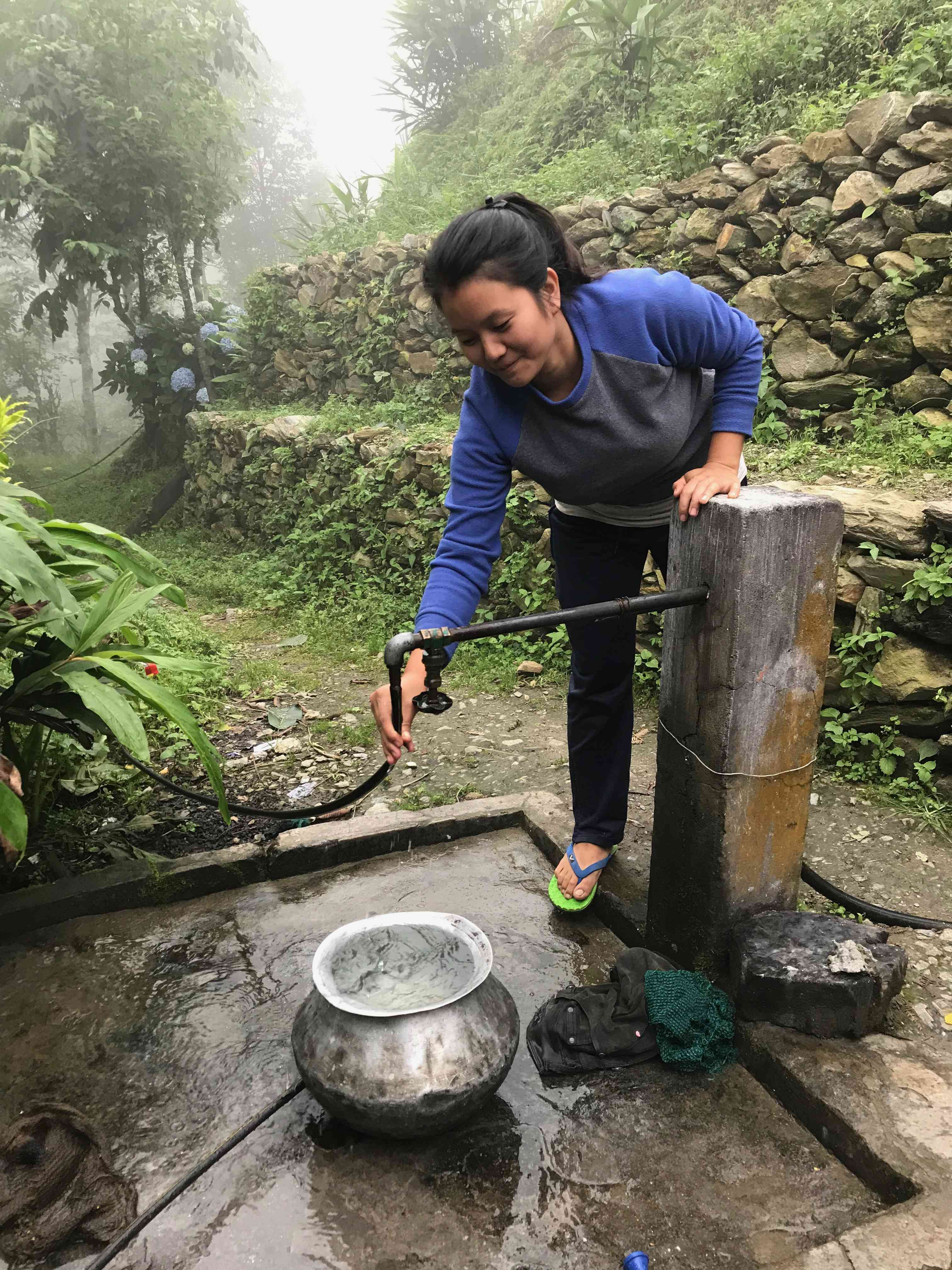 Manisha Mangar, a resident of Lower Gupti, says Dhara Vikas has increased the flow in the spring which supplies water to her village. They now get water throughout the year. Photo credit: Nidhi Jamwal