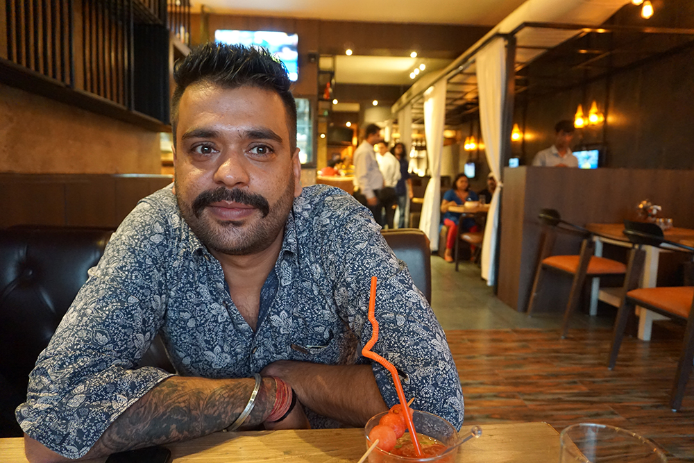 Rahul Wahi, a millennial looking for a bride, at a restaurant he owns. Wahi is wary of dating apps or social networking sites as they require men to be sharp on chat to be able to attract women. He is comfortable with photo-sharing app Instagram. Photo credit: Aparna Kalra