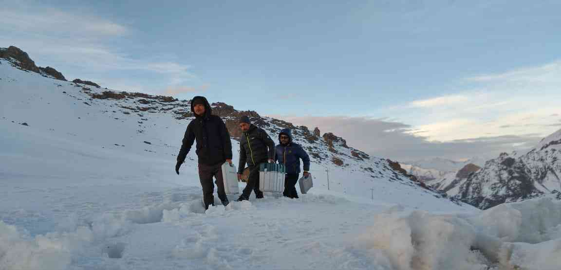 Election Commission staff walk through Ladakh's Hamboting La Pass on their way to the the Batalik sector to conduct Electronic Voting Machine-Voter-Verified Paper Audit Trail awareness camps.