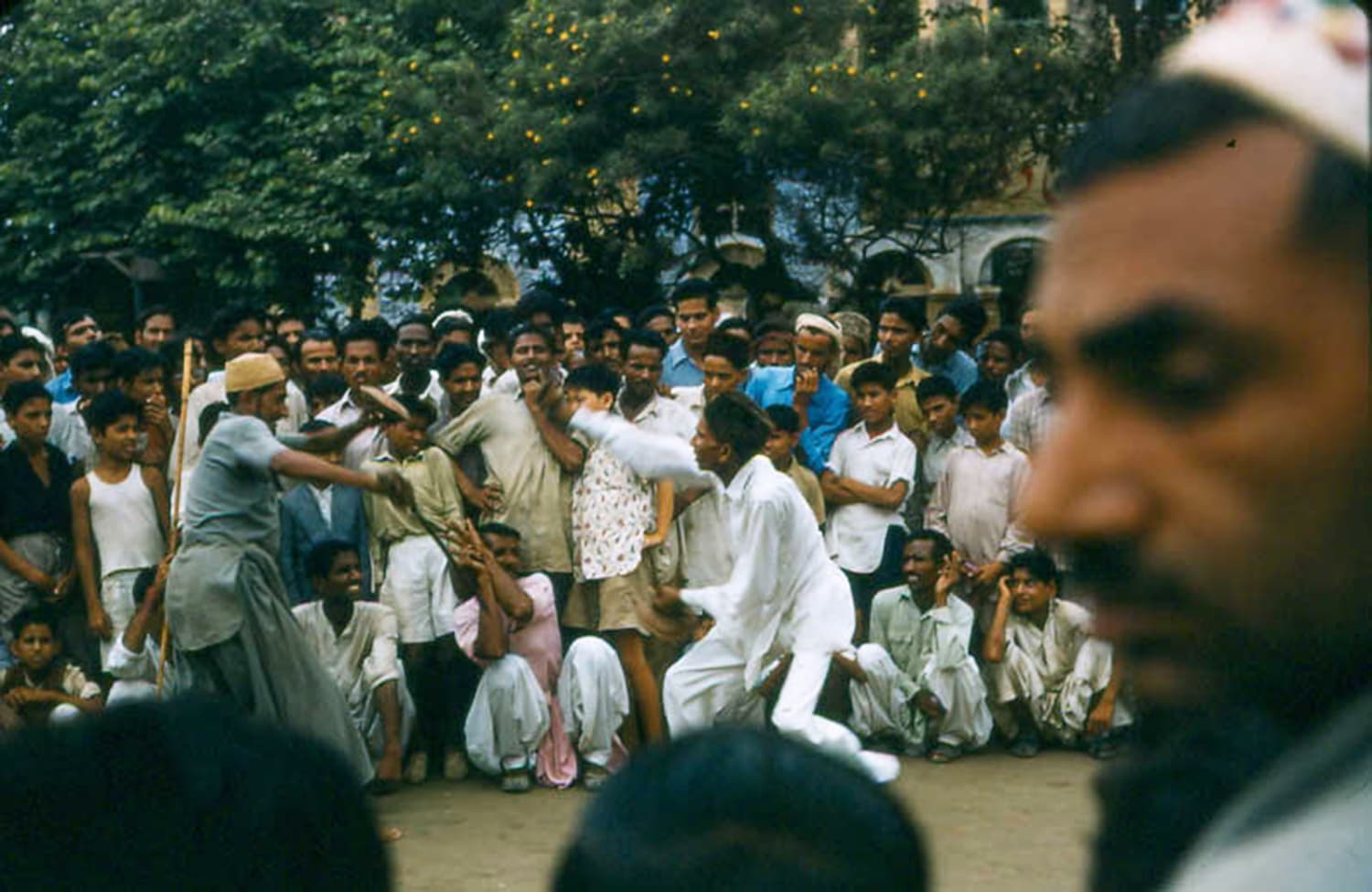 1957: Mohajir street actors re-enact scenes of violence during the partition of India and which forced many of them to migrate to Karachi.