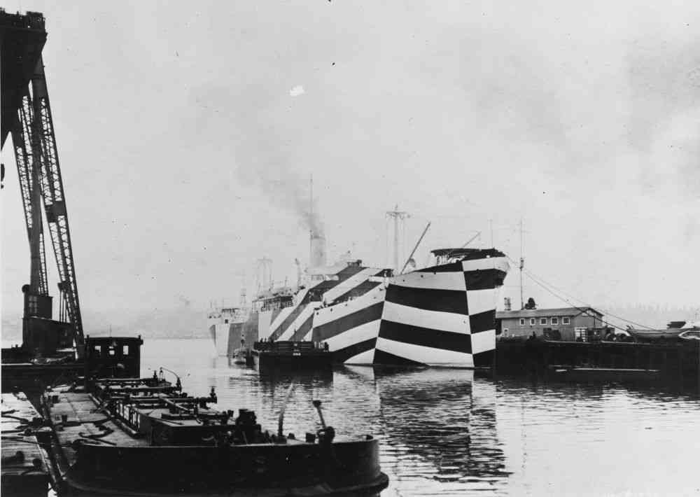 The SS West Mahomet's stripes were intended to make it difficult to point the ship's location or gauge its speed. Photo credit: Bureau of Ships Collection in the US National Archives/Wikimedia Commons [Public Domain].