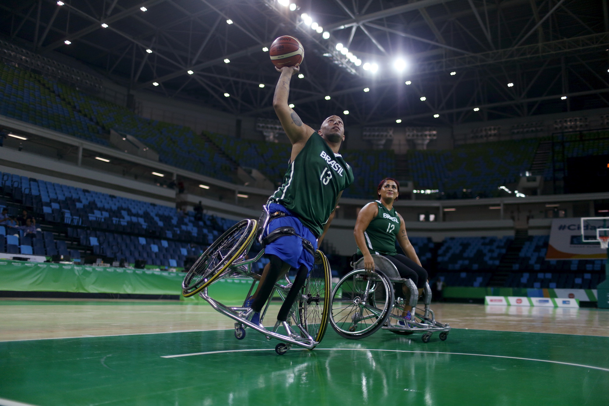 Paralympic athlete Leandro de Miranda throws a basketball. Image credit: Pilar Olivares / Reuters