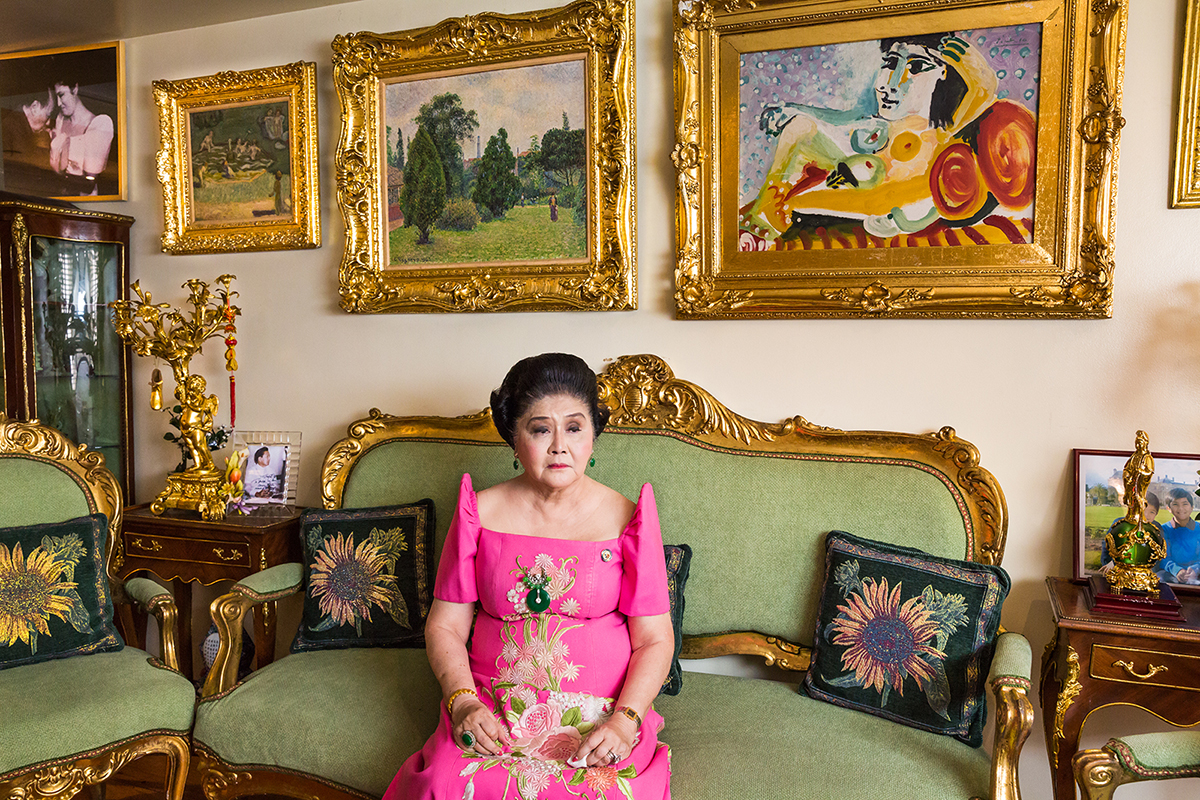 "'Imelda Marcos', by Lauren Greenfield, from the series 'Generation Wealth', the photographer's 25-year visual history of our growing obsession with wealth. Pictured here is Imelda Marcos, 84, in her apartment in Manila, Philippines, 2014, surrounded by expensive artwork. She and her late husband, Philippine President Ferdinand Marcos, were referred to as a ""conjugal dictatorship"". They were accused of stealing up to $10 billion from their country. © Lauren Greenfield, United States of America, Shortlist, Professional, Contemporary Issues (Professional competition), 2018 Sony World Photography Awards."