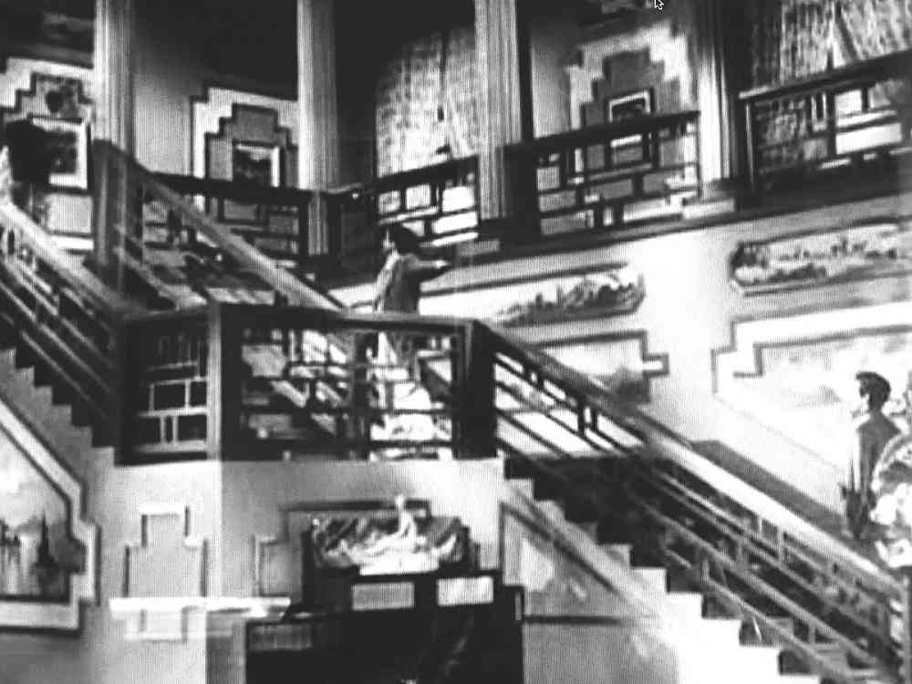 Nargis at the top of the staircase, followed by Raj Kapoor and Dilip Kumar in Mehboob Khan's Andaz (1949). Courtesy Mehboob Productions Pvt Ltd/Hyphen Films Collection.