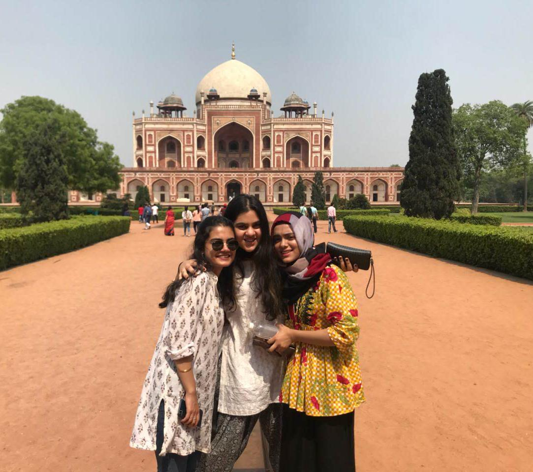 """Pakistani students Kainaat Jah, Maria Khan and Maryam Ahmad Kiyani at Humayun's tomb in Delhi. Kiyani pointed out that she was the only one in a hijab and therefore stood out in the Sonipat campus. """"The rest look like Indians,"""" she said."""