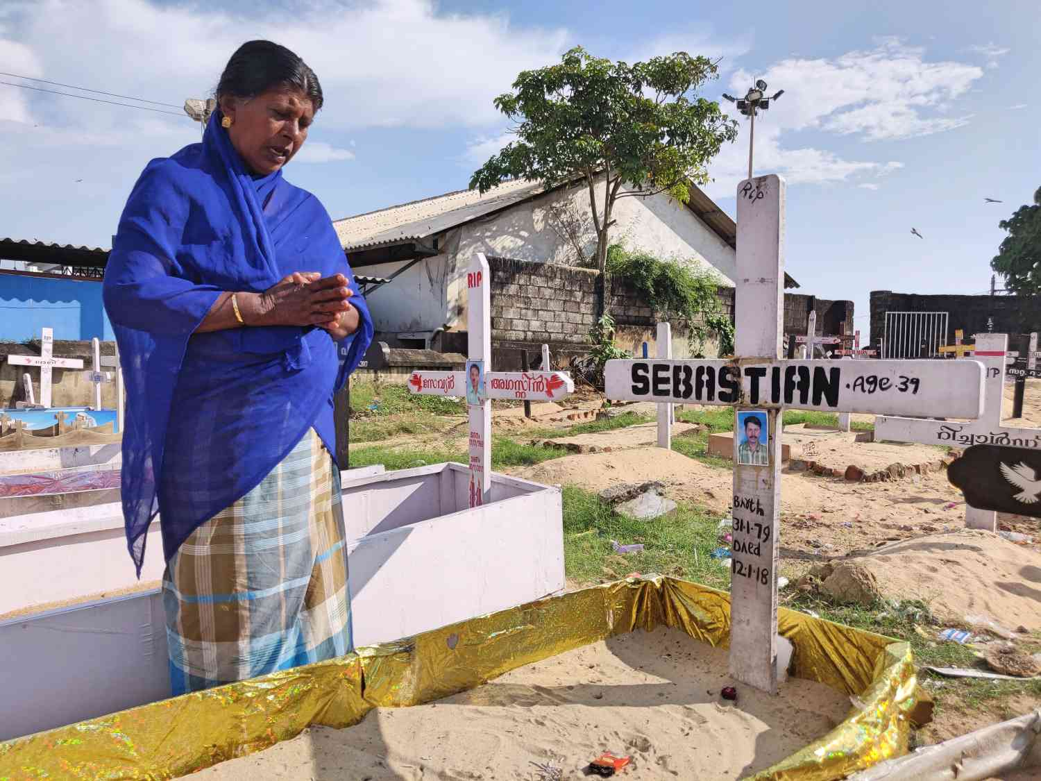 Vizhinjam resident Blasita Pathrose prays at the grave of her son Sebastian, a fisherman who lost his life due to Cyclone Ockhi in November 2017.