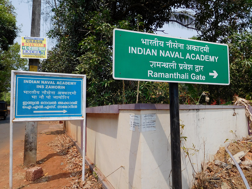A signboard showing the way to to the Indian Naval Academy at Ezhimala.