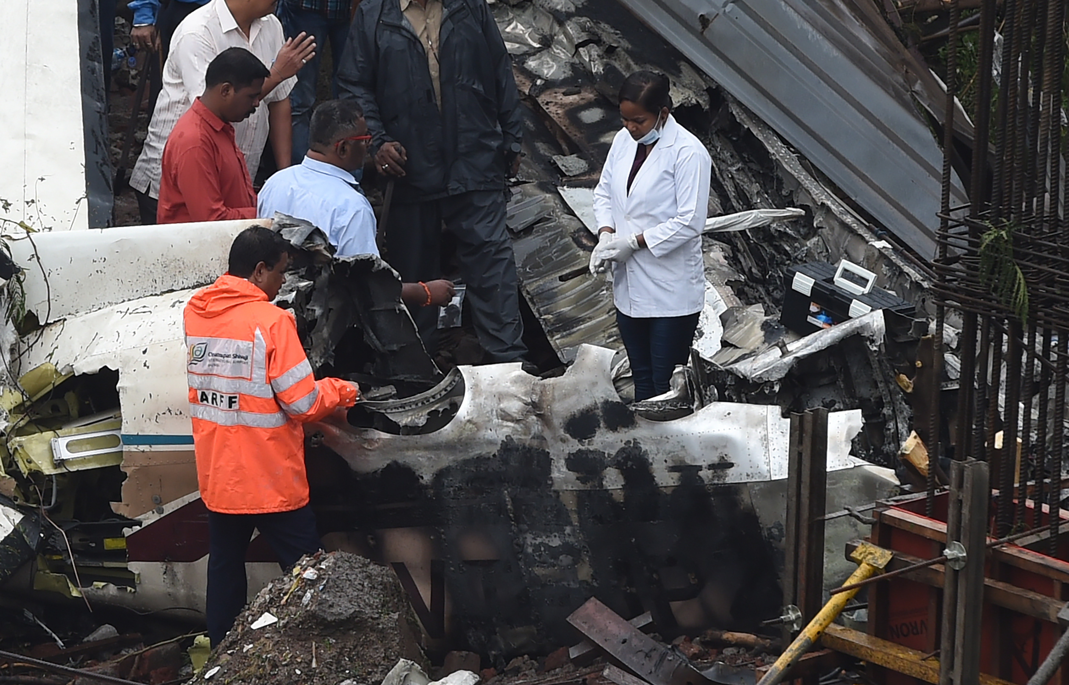 Investigators at the site of the plane crash on Thursday. (Credit: AFP)