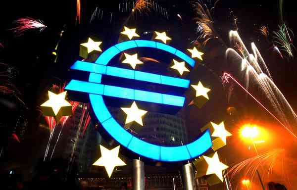Fireworks illuminate the sky around a huge euro sculpture. Photo Credit: Reuters/Kai Pfaffenbach