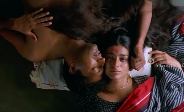 Prakash Raj and Tabu in Iruvar (1998).