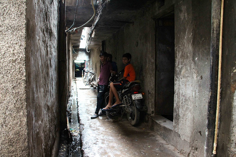 On the right, the Singh family's previous home in galli 14, Saket Block.
