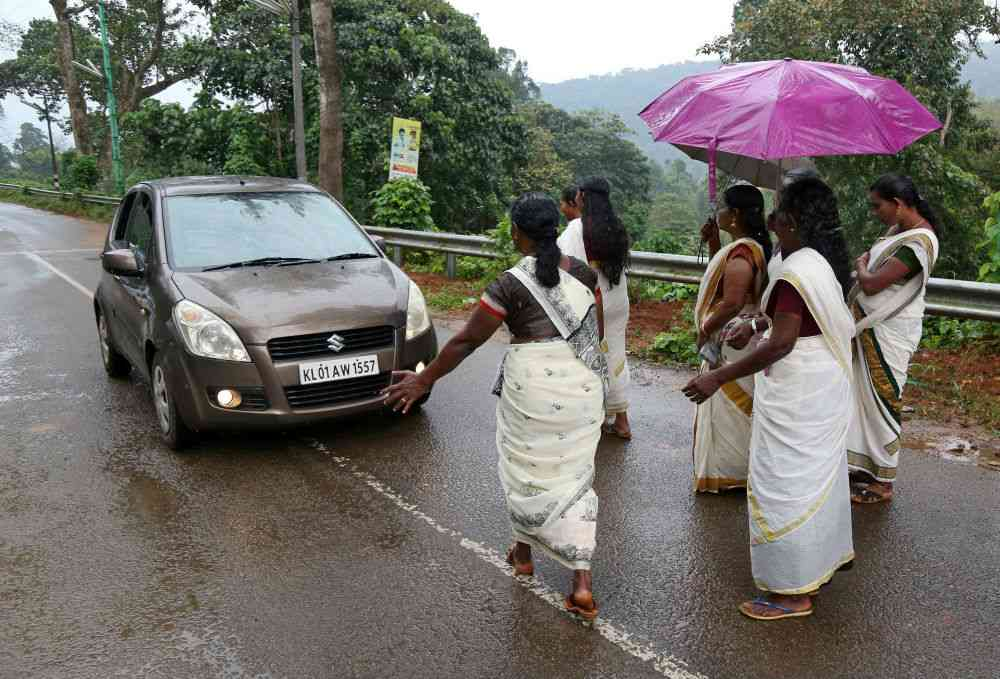 Devotees stop a car to check if any women of menstruating age are headed towards the Sabarimala temple, at Nilakkal Base camp in Kerala's Pathanamthitta district, on October 16, 2018. Photo credit: Sivaram V/Reuters.