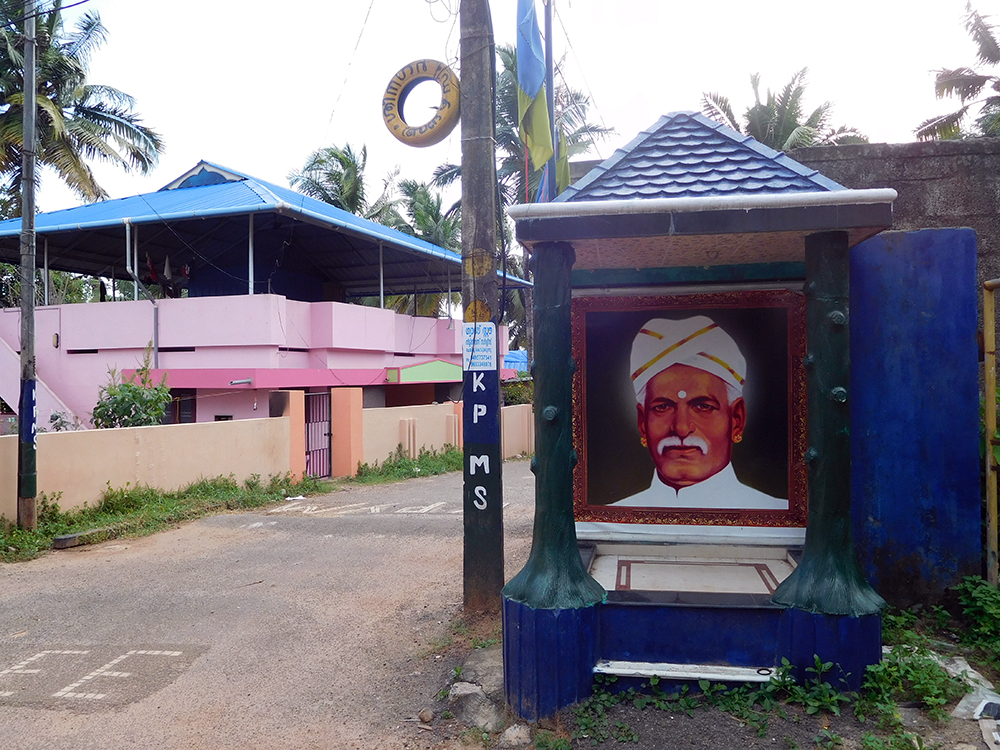 Dalit social reformer Ayyankali's portrait and Kerala Pulaya Maha Sabha flags in one of the streets in Panachakkunnu Colony in Kallampally in Thiruvananthapuram. (Photo credit: TA Ameerudheen).