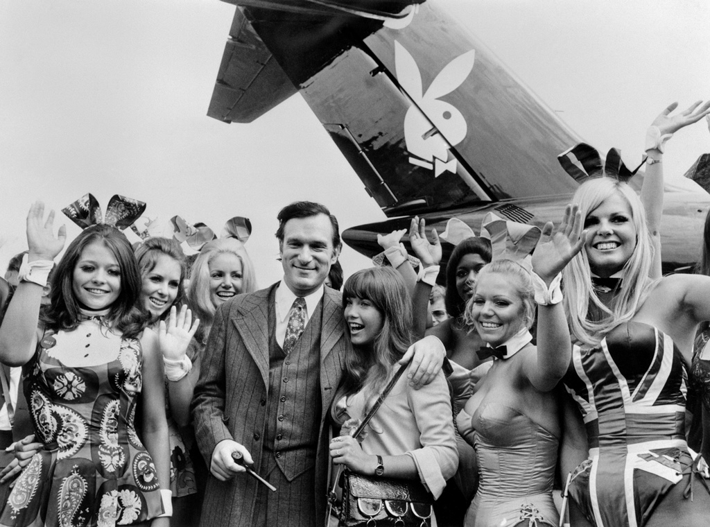 "'Playboy' publisher Hugh Hefner and playmates arrive at Le Bourget airport on the Playboy jet ""Big Bunny"". Photo credit: AFP"