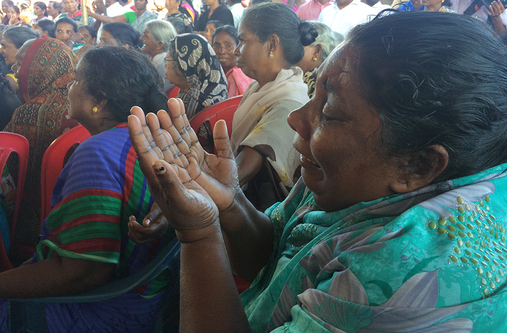 Women in Vizhinjam weep after hearing about a death of a fisherman on Monday. Photo credit: TA Ameerudheen