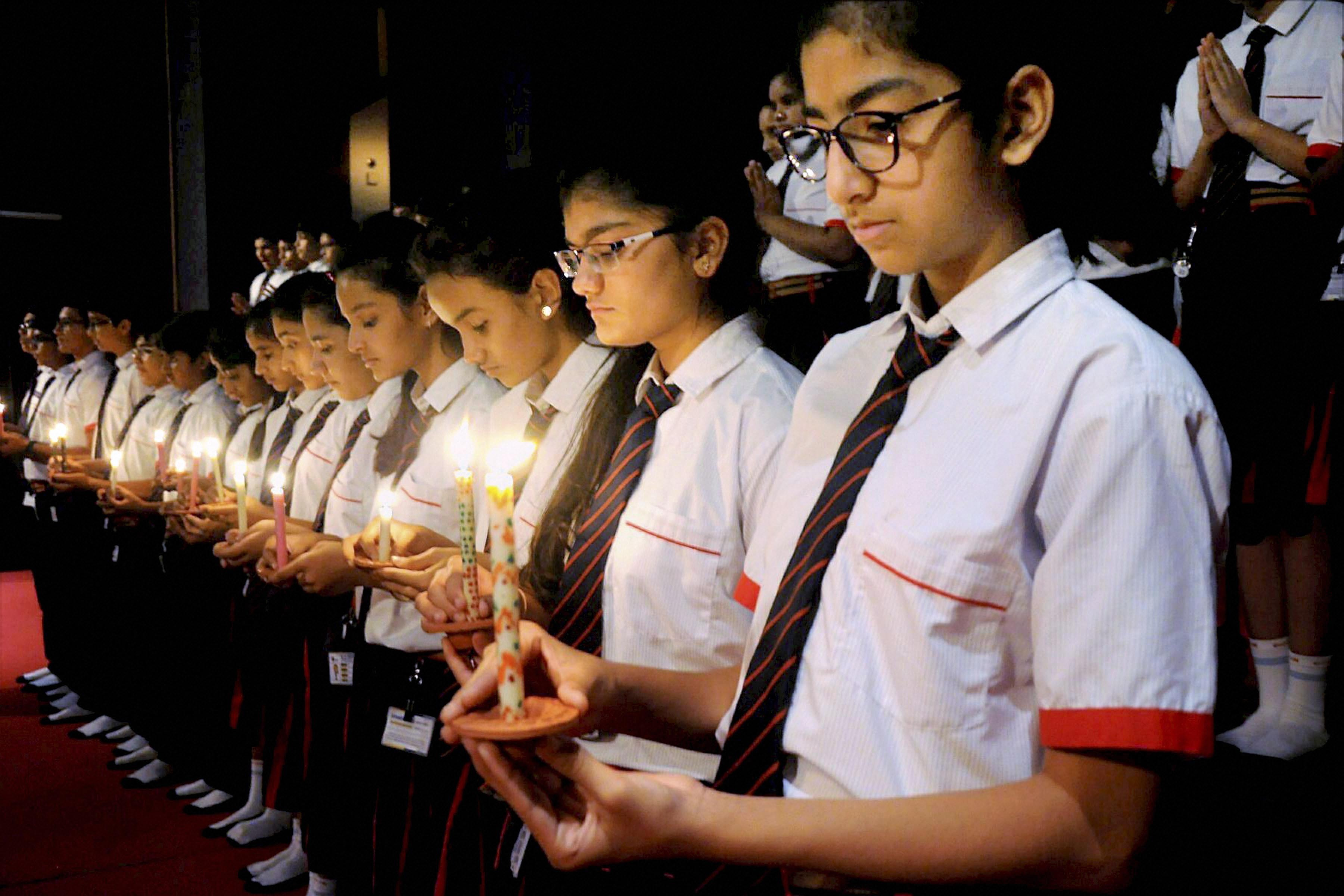 Students pay tribute to the victims of the Amarnath Yatra attack at a school in Surat, Gujarat. (Pic: PTI)