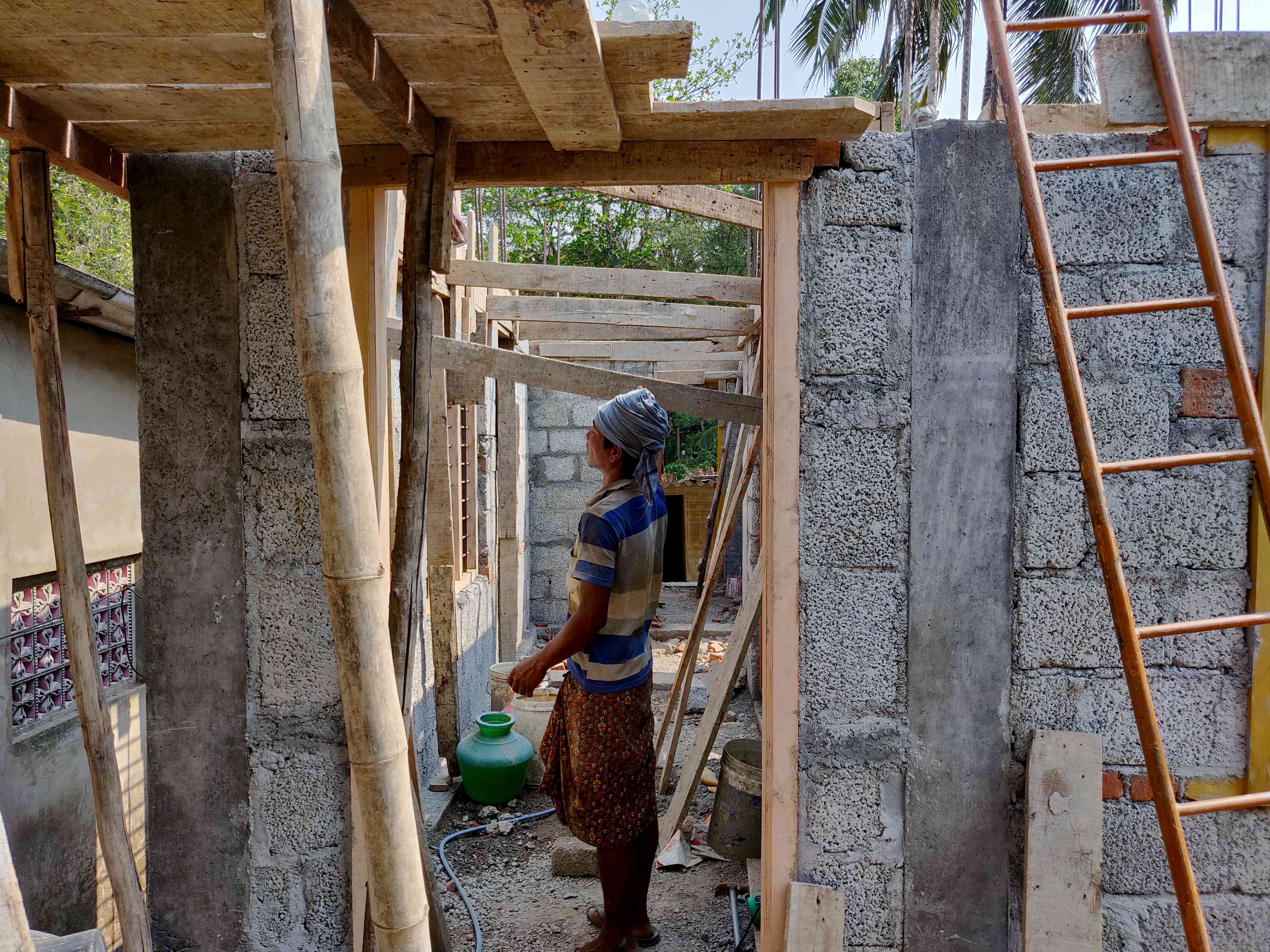 Rajamani is rebuilding her home in Aranmula with the first installment of the compensation she received recently. Photo credit: TA Ameerudheen